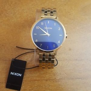 Gold plated mens Nixon watch